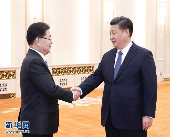 习近平会见韩国总统特使郑义溶