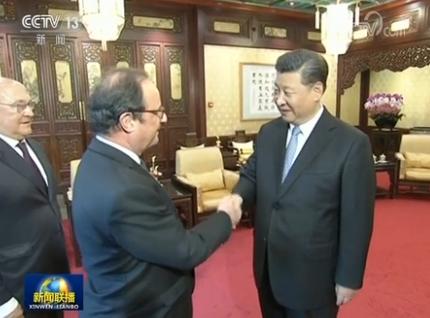 习近平会见法国前总统